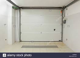private garage interior with closed door from inside stock image