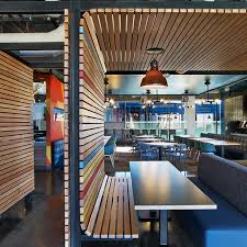 Google orange county offices Tel Aviv Google Orange County Mashstudios Custom Cafe Booths With Natural Oak In Red Orange Yellow And Red Slats Pinterest Google Orange County Mashstudios Custom Cafe Booths With Natural