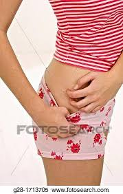 Stock Image of arms of young woman scratching her itching hip in red ...