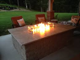 outdoor fire table. Unilock Outdoor Firetable With Travertine Table Top Fire
