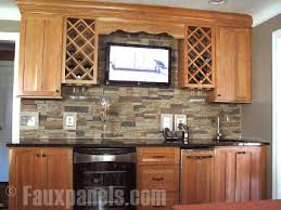 The use of several distinct colors in the faux stone backsplash ensures  contrast while also picking