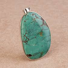 large turquoise pendant crafted in fine sterling silver