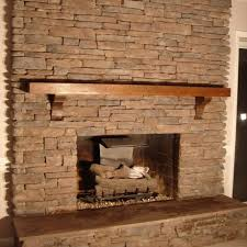 bricks accent wall fireplace design with wooden fireplace mantel for vintage home decor a part of