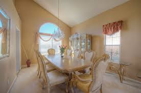 minimalist overwhelming dining room light fixtures. Charming Traditional Dining Room With Classic Chairs And Table Completed By Vase Decoration Furnished Minimalist Overwhelming Light Fixtures