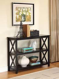 Wall Mounted Picture Frame Above Small Wood Console Table With Shelf And  Rattan Basket Storage Painted With Black Color For Narrow Hallway Ideas