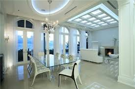 luxury home lighting. perfect home modern allwhite home with open living space containing large dining room  glass table on luxury home lighting