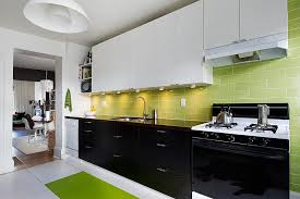 view in gallery black white and green kitchen