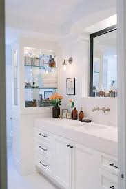 white bathroom cabinets with bronze hardware. well appointed white and black bathroom features a washstand contrasted with oil rubbed bronze hardware fitted thick quartz cabinets o