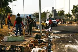 looting tear through South Africa ...