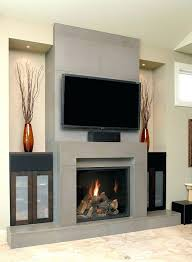 adorable grey concrete wood burning fireplace surround under wall mounted units contemporary design flat screen tv