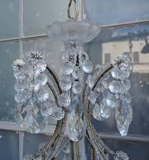 eight light italian crystal beaded chandelier with giltwood bobeches newly rewired with drip wax