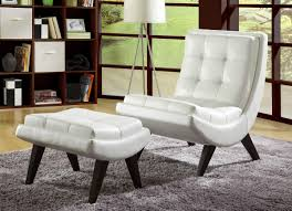 contemporary accent chair paired with ottoman comes in white faux leather with on tufting in curved