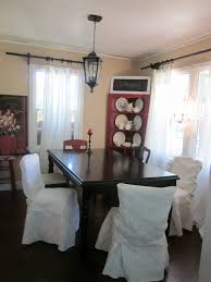 cozy white and black dining room chair covers decoration with interesting dark wooden dining table design