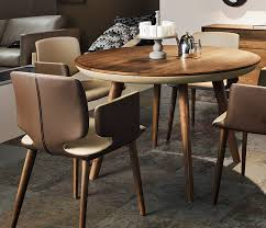 gorgeous high end luxurious dining room table in solid walnut wood and leather
