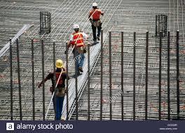 ironworkers carrying long rebar i 880 cypress project oakland california usa rebar worker
