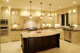 image popular kitchen island lighting fixtures. luxurious kitchen awash in light marble tones dominated by large dark wood island with filigreed image popular lighting fixtures s