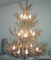 to enlarge 12 light three tier mule deer antler chandelier
