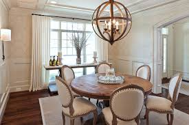54 inch round dining room transitional with cage chandelier wood molding