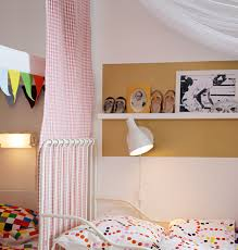 close up of fabric room divider and canopy over a child s ikea bed