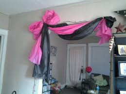 drape a doorway with plastic table cloth, pink