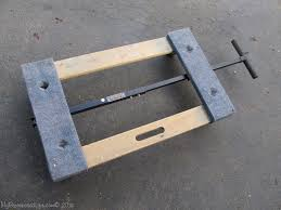 the handle folds under the furniture dolly and clips in place for easy storage i can tell you that since i got it i have used it a lot