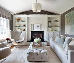 cozy living rooms. An Elegant Button-tufted Rectangular Ottoman Adds Texture And Warmth To This Lovely Living Room Cozy Rooms