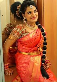 south indian bride bridal makeup and hairstyle for reception wedding sarees orange blouse reception design bridal hairstyles