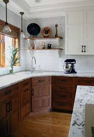white and wood cabinets. Evaluating The Task Of Remodeling Kitchen Really Liking Upper White Cabinets With Lower Dark Wood From Centsational Girl In And