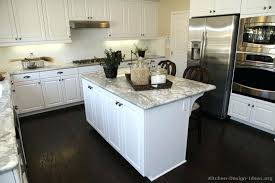 white kitchen cabinets with dark countertops kitchen kitchen cabinets traditional white island wood floor marble kitchen