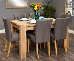 baumhaus aston oak dining set with 6 flare back grey upholstered chairs baumhaus aston oak dining set