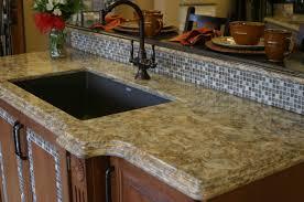 quartz countertops. Black-kitchen-with-cambria-quartz-countertops-l-a795ec5408734699 - Quartz Countertops