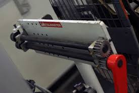 a bead roller is a machine tool that makes rigid lines in sheet metal to make surfaces more rugged and durable