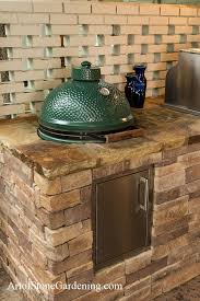 a big green egg do grill ceramic grill or charcoal smoker grill is a popular accessory for an outdoor kitchen design here we have built the bge into