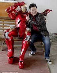 heroic effort cheng chen poses with the iron man suit he built after six months