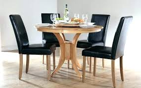 white round dining table set for 4