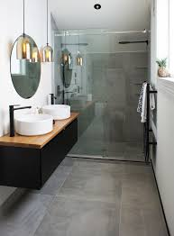 Cat & Jeremy's Ensuite uses the Cementia Grey 75 tile, makes the space look  larger
