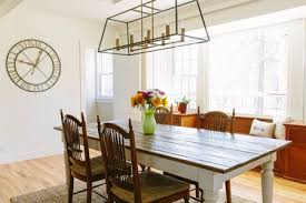 modern farmhouse dining room with geometric chandelier