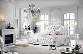 Romantic bedroom with French style, tufted headboard bed, fireplace,  chandelier and make-
