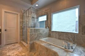 light above shower above shower bathroom window with built in bathtub and marble bathroom tile also
