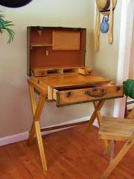 Old wooden suitcase repurposed into a desk, with a drawer for storage
