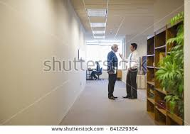 office hallway. beautiful hallway businessmen talking in office hallway in office hallway d