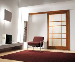 perfect design of sliding interior doors made of glass material with brown wooden frames