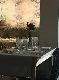el boliche cebicheria dining table and waterfall window