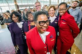 delta employees celebrate at the atlanta fashion show previewing the company s new uniforms designed by zac posen