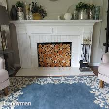fireplaces can be cozy in the winter but does yours collect dust the rest of the year create the look of stacked logs with this easy wood log faux