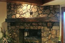 attractive stone fireplace with wood mantel wooden shelf for piece mantle storage surround burning stove trim