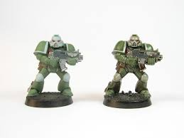 a space marine miniature from warhammer 40k shaded using the dip