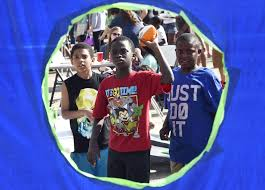 photo gallery block party at the apostolic promise church kasey peters and tj mitchell watch darian jones throw a football during a block party on 15 2017 at the apostolic promise church in cape girardeau