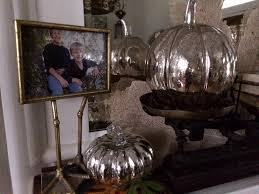 the parlor mantle changes seasonally this november i added four mercury glass pumpkins two to the vintage scale and two atop stacks of books