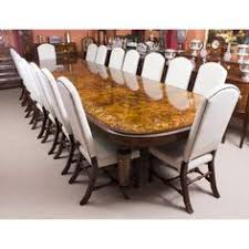 a large bespoke handmade victorian style marquetry dining set which prises a burr walnut dining table